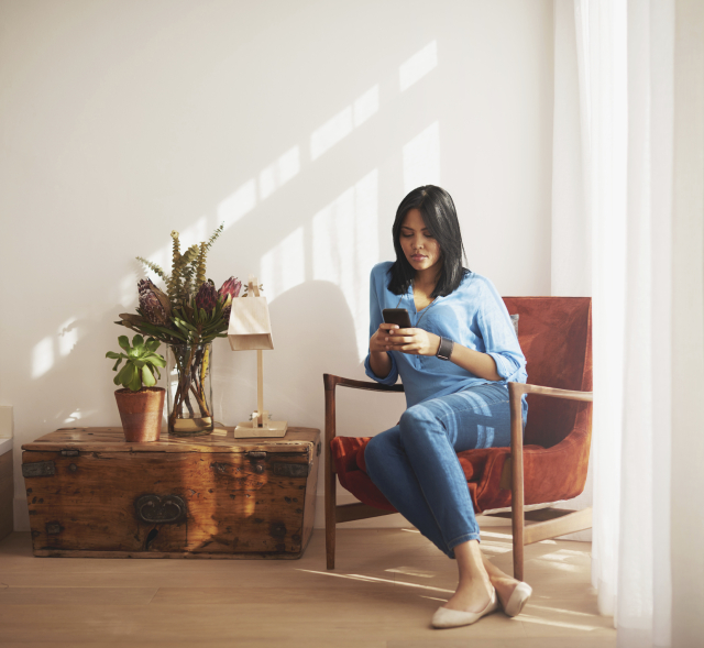 Woman sitting on a chair using her cellphone
